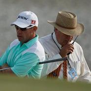 Brian Davis waits for the ruling from on-course referee Slugger White