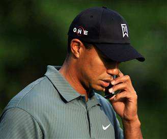 Tiger Woods on his Cellphone